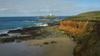 The beach at Godrevy with the lighthouse in the distance