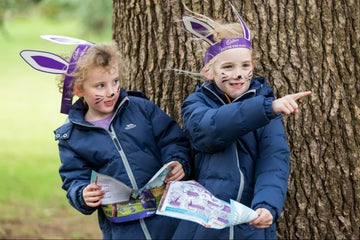 Hiding behind a tree on a Cadbury Egg Hunt