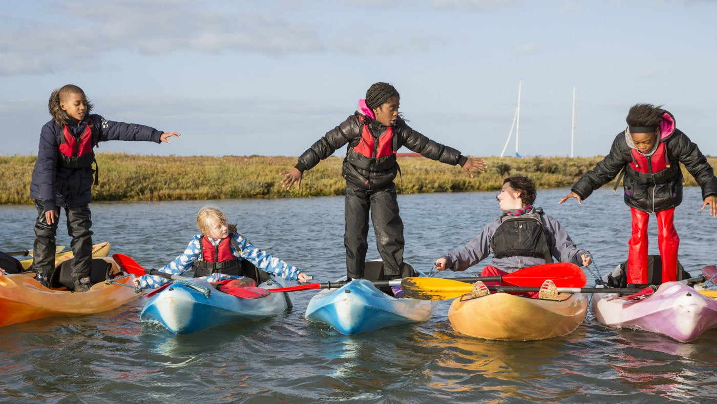 Children kayaking at Brancaster Activity Centre, Norfolk