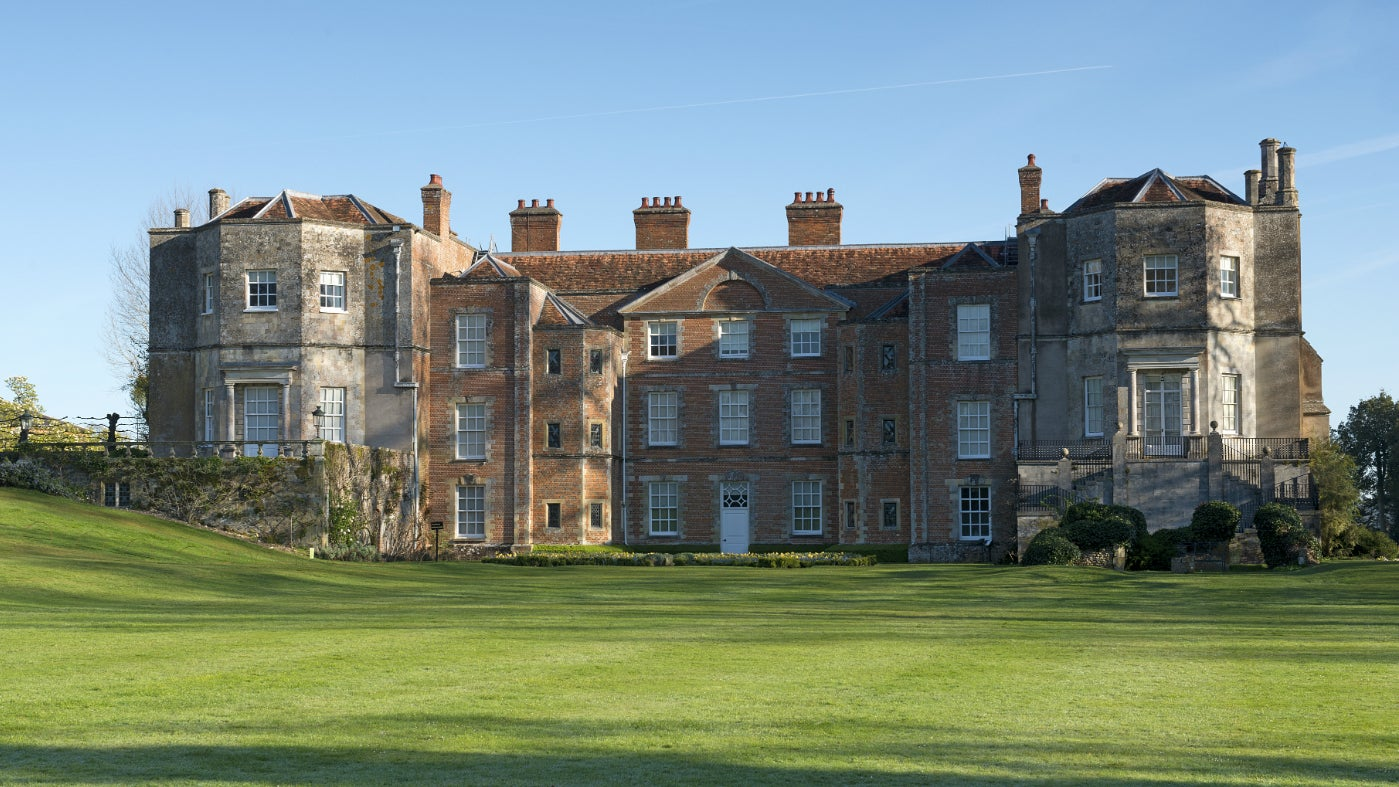 The south front of the house in spring sunshine at Mottisfont, Hampshire