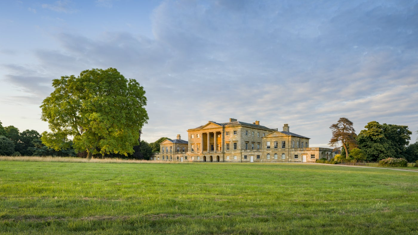 West front of the mansion at Basildon Park from across the parkland