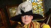 Boy dressed in costume at Elizabethan House Museum