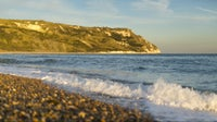 Cliff views across Ringstead Bay from the beach