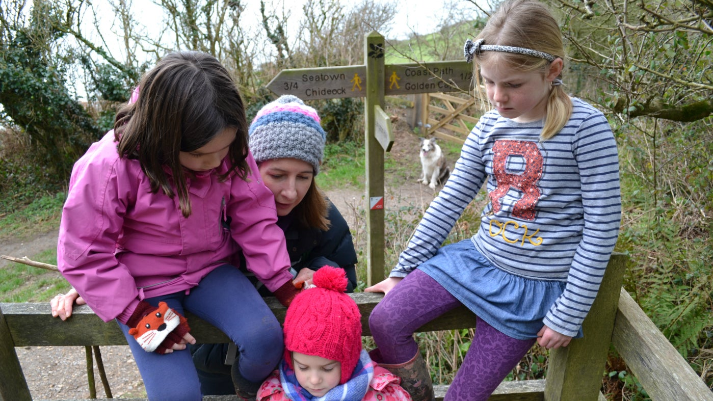 Family gathers to study an orienteering map
