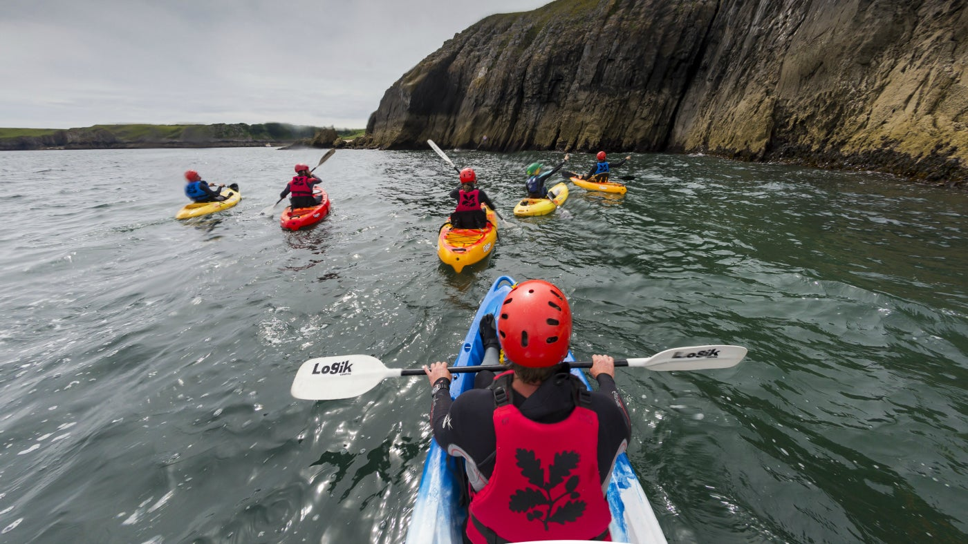 A group kayaking off Stackpole