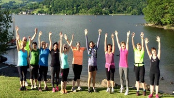 Running group enjoying the lakeshore at Wray Castle