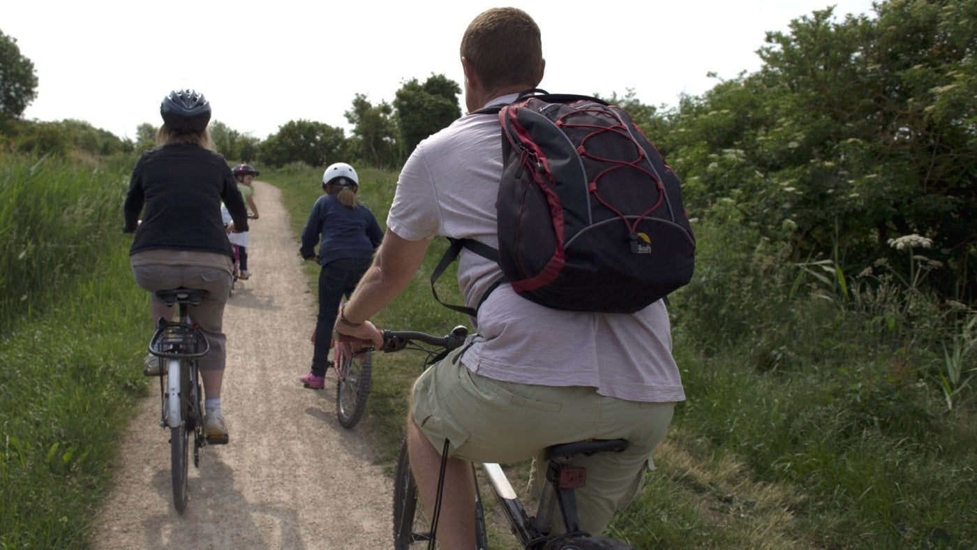 A family cycle along a countryside track