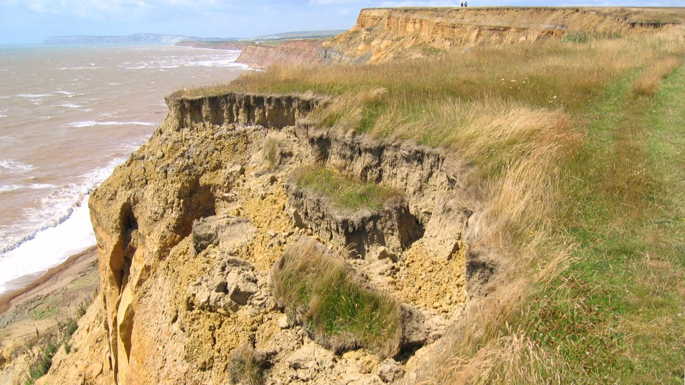Sandy cliffs are crumble towards the sea shore on the south of the Isle of Wight