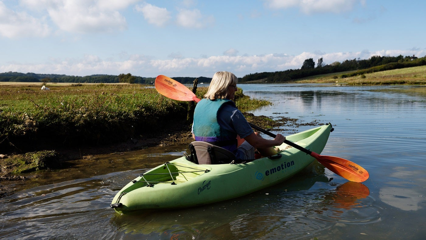 Lady in a kayak at Newtown National Nature Reserve, Isle of Wight
