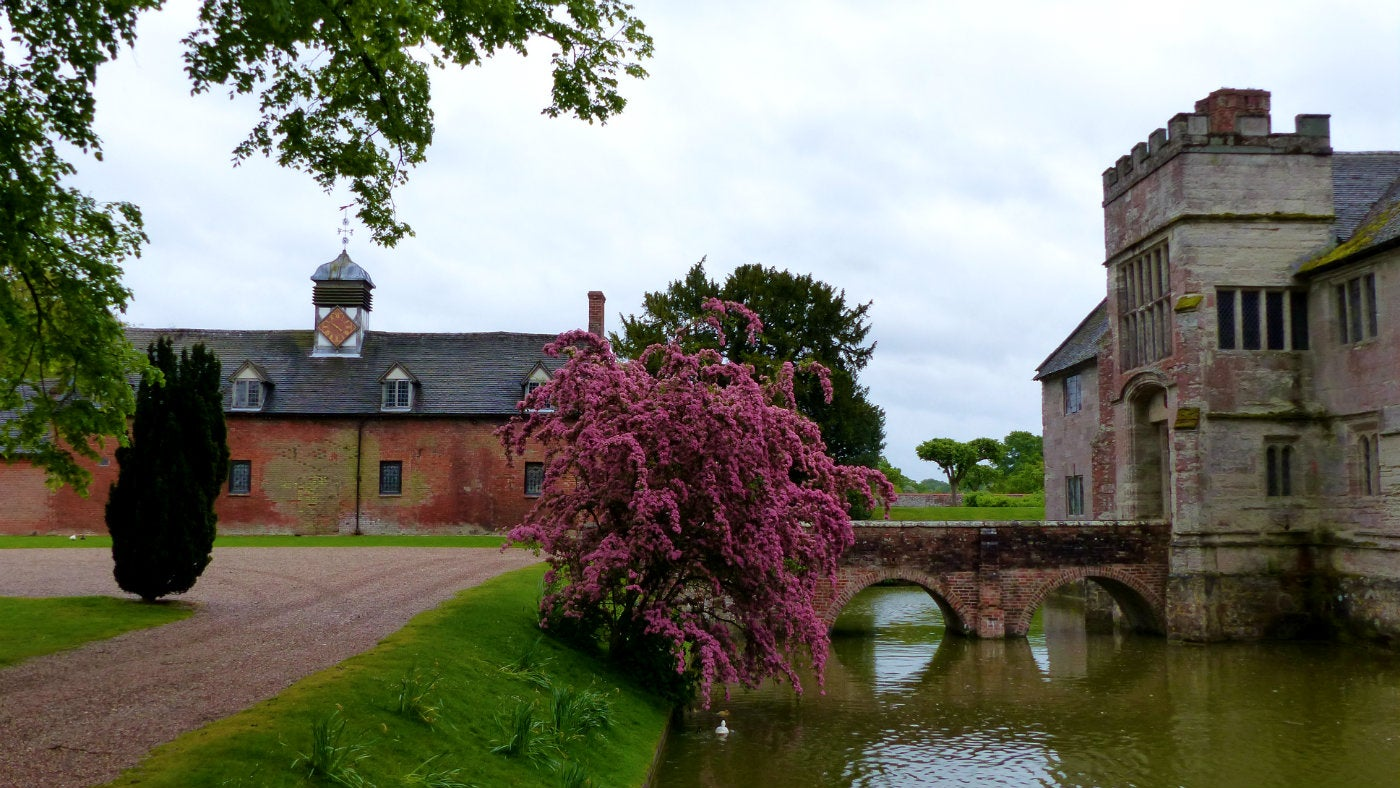 The house and the moat at Baddesley on a spring morning