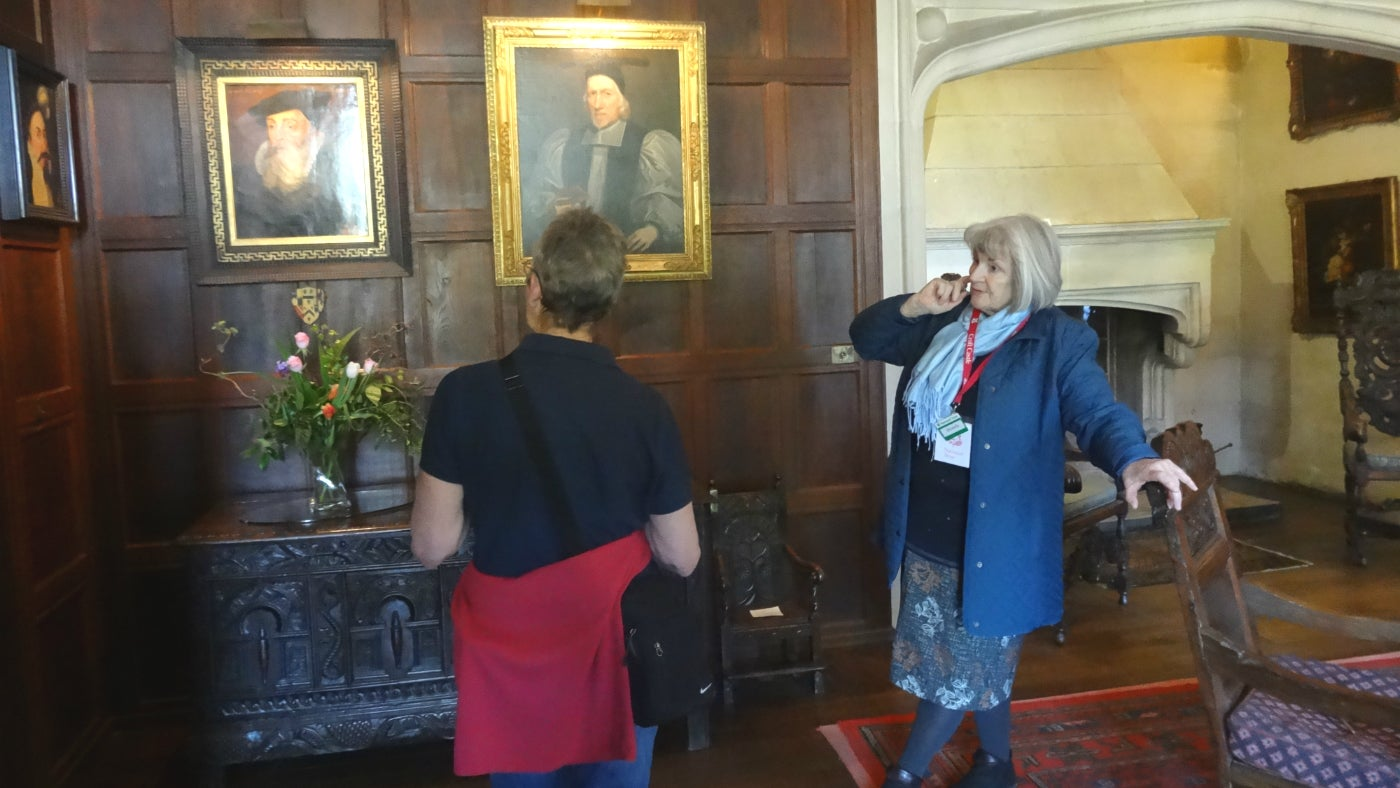 Bronda talks to a visitor in the hall about the history of the Croft family, at Croft Castle in Herefordshire