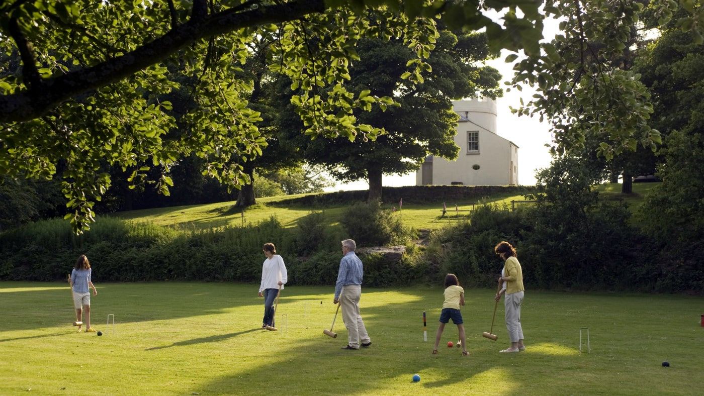 A family enjoying the grounds and a game of croquet at The Kymin, Monmouth, Wales