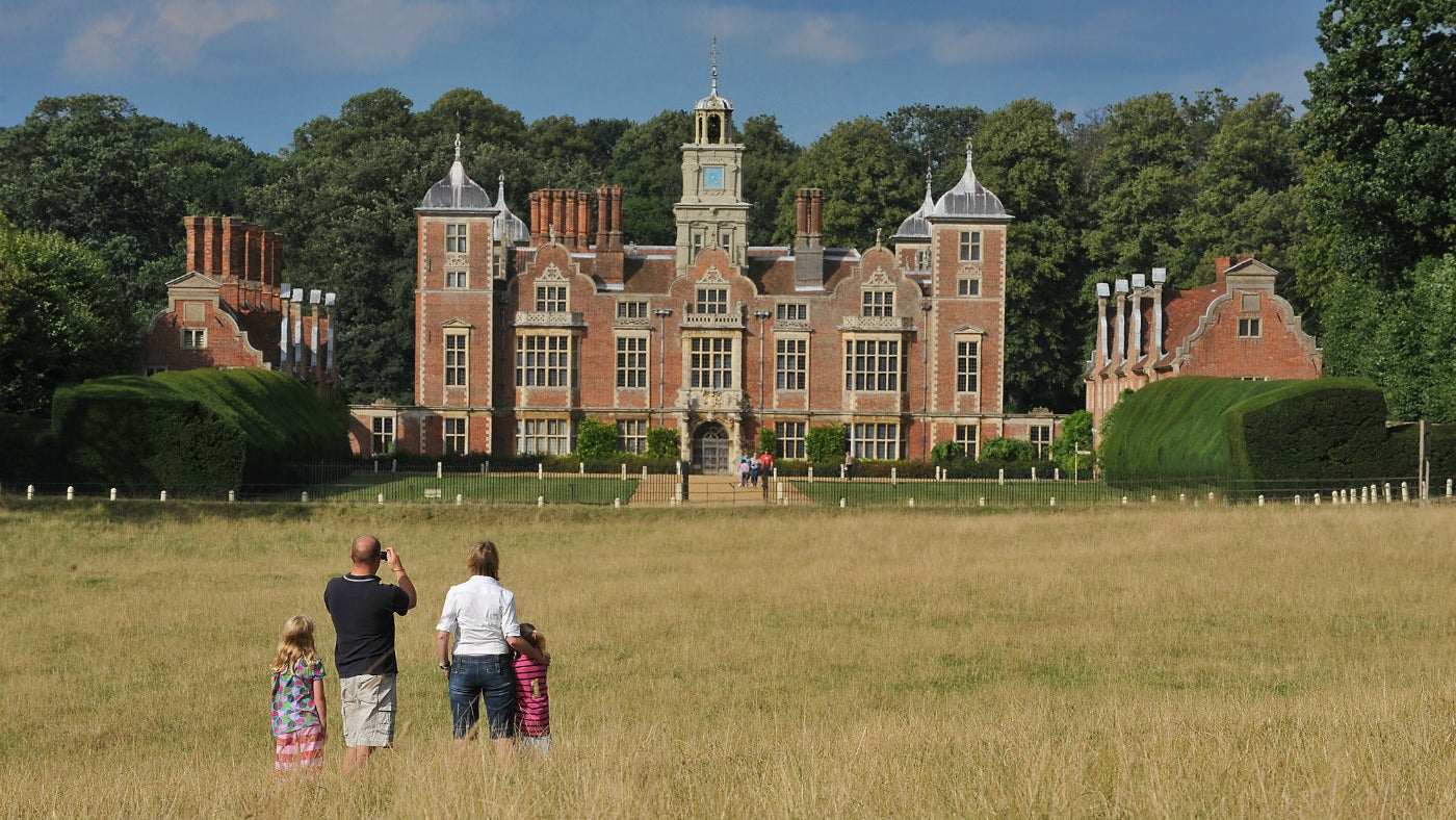 A family of four taking in the view of Blickling Hall
