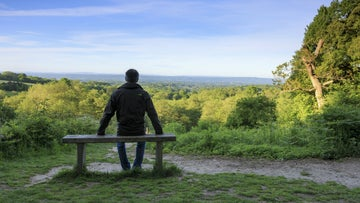 A visitor enjoying the views at Emmetts Garden, a National Trust property in Kent