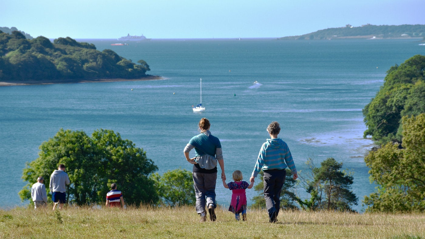 Explorer family in the parkland at Trelissick, Cornwall