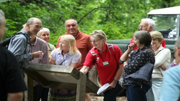 Visitors enjoying a guided walk from volunteer parkland guides at Killerton