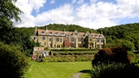 Visitors enjoying Mount Grace Priory house and garden on a sunny summer's day