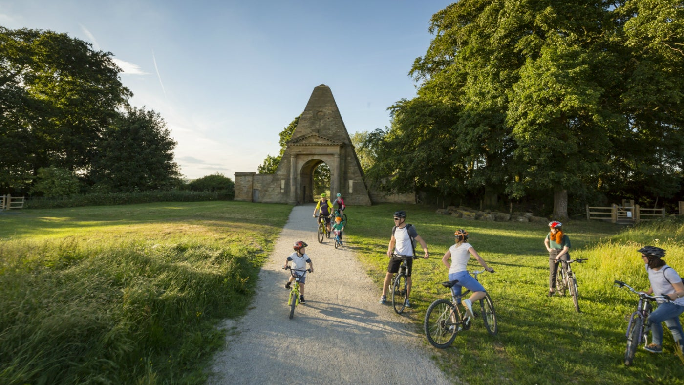 Family cycles through parkland at Nostell