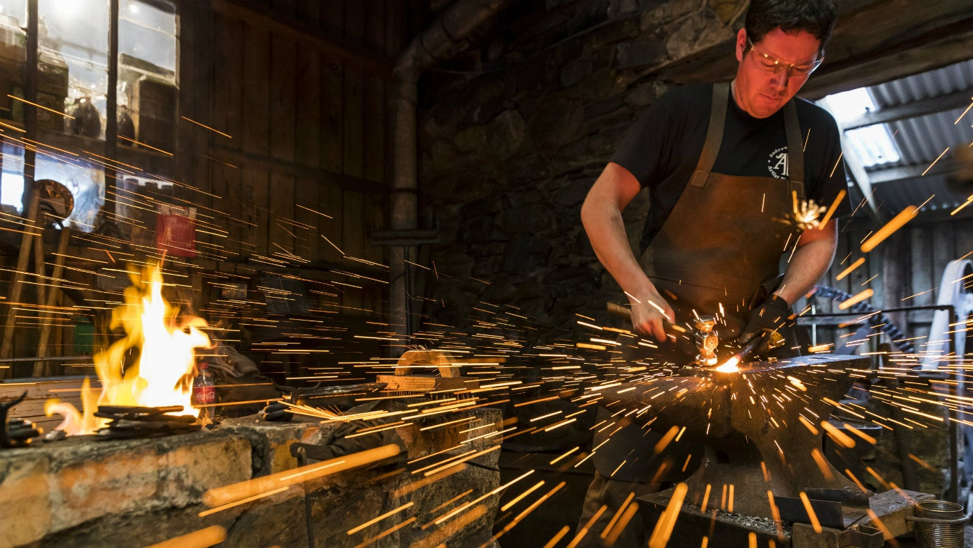 Blacksmith at work, Finch Foundry, Devon