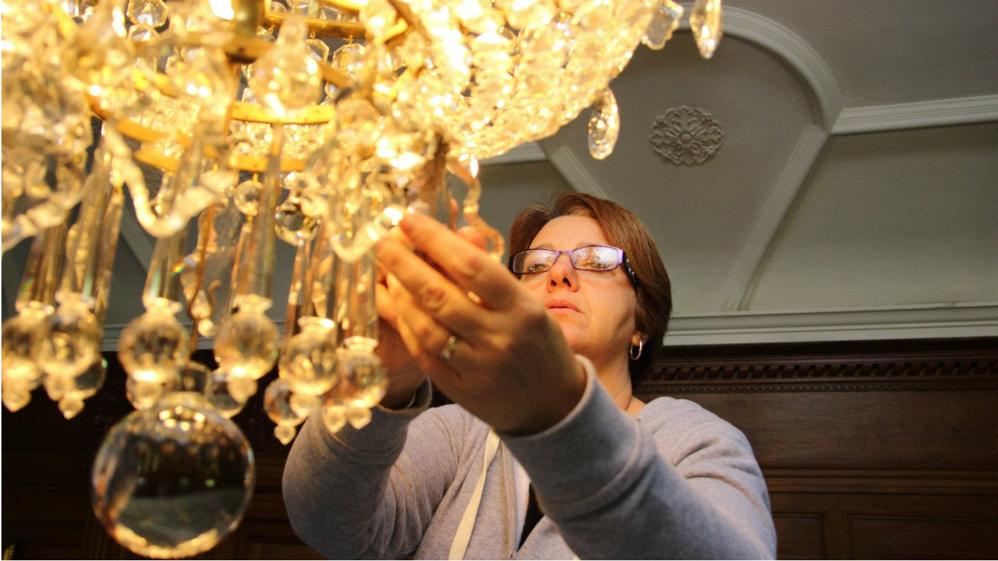 Cleaning the chandelier at Lanhydrock, Cornwall