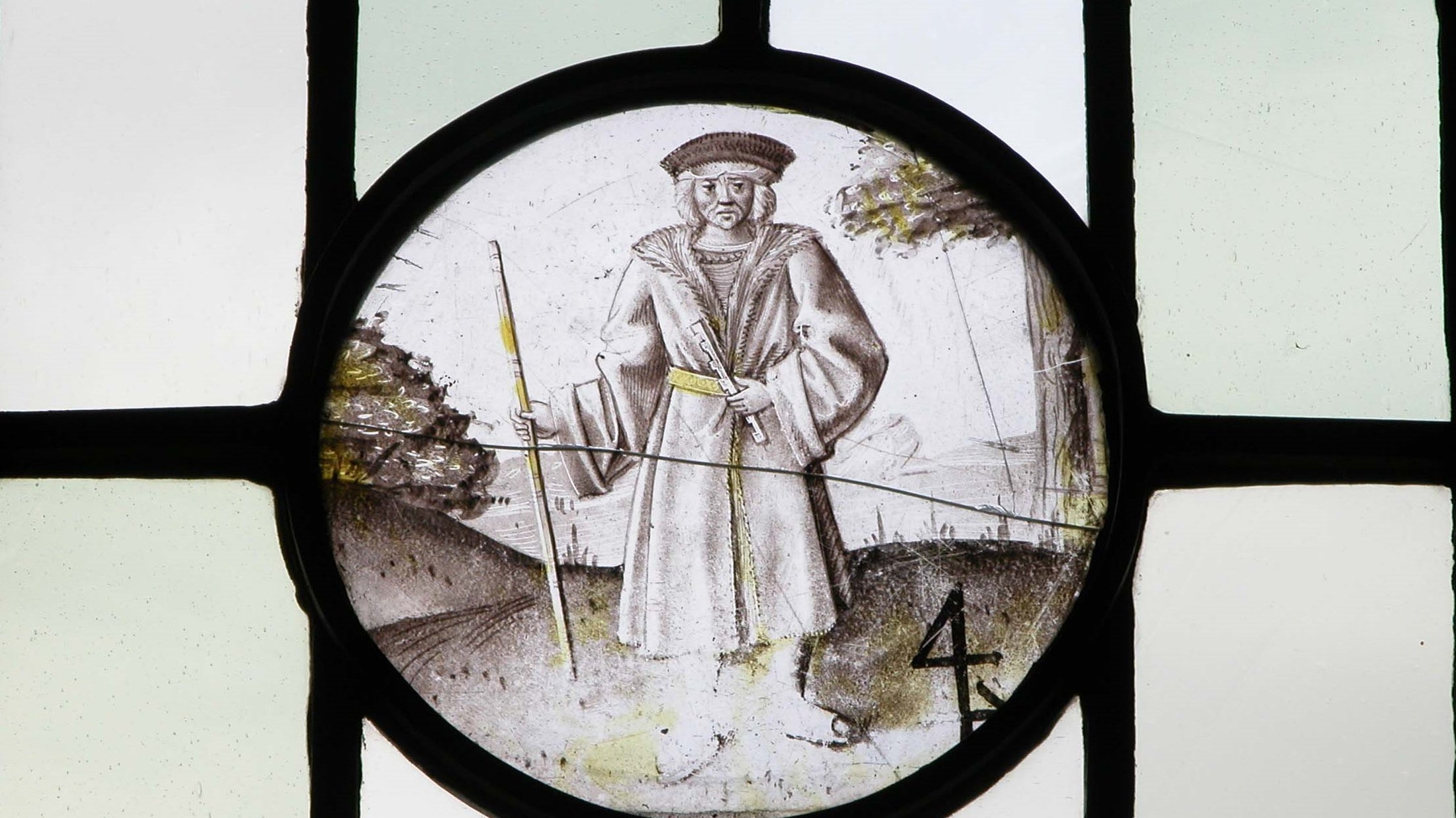 A 16th century stained glass panel with the figure of a pilgrim at Packwood House
