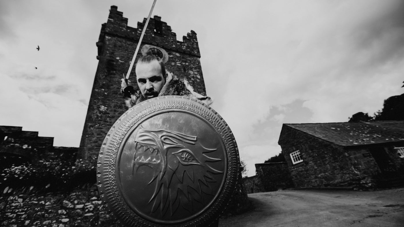 A warrior in brandishes his sword at the Winterfell Tower House at Castle Ward Co. Down
