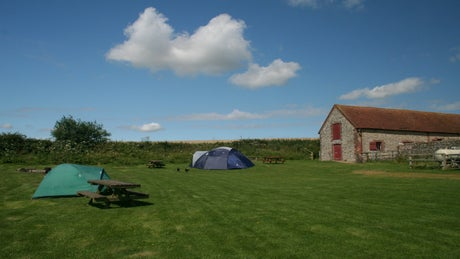 A view of Gumber campsite and barn, Slindon