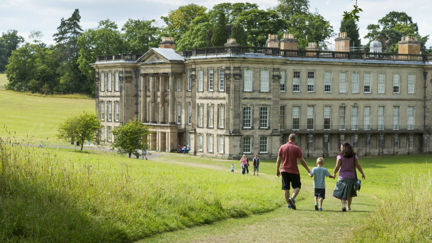 Visitors walking to the house at Calke Abbey in Derbyshire