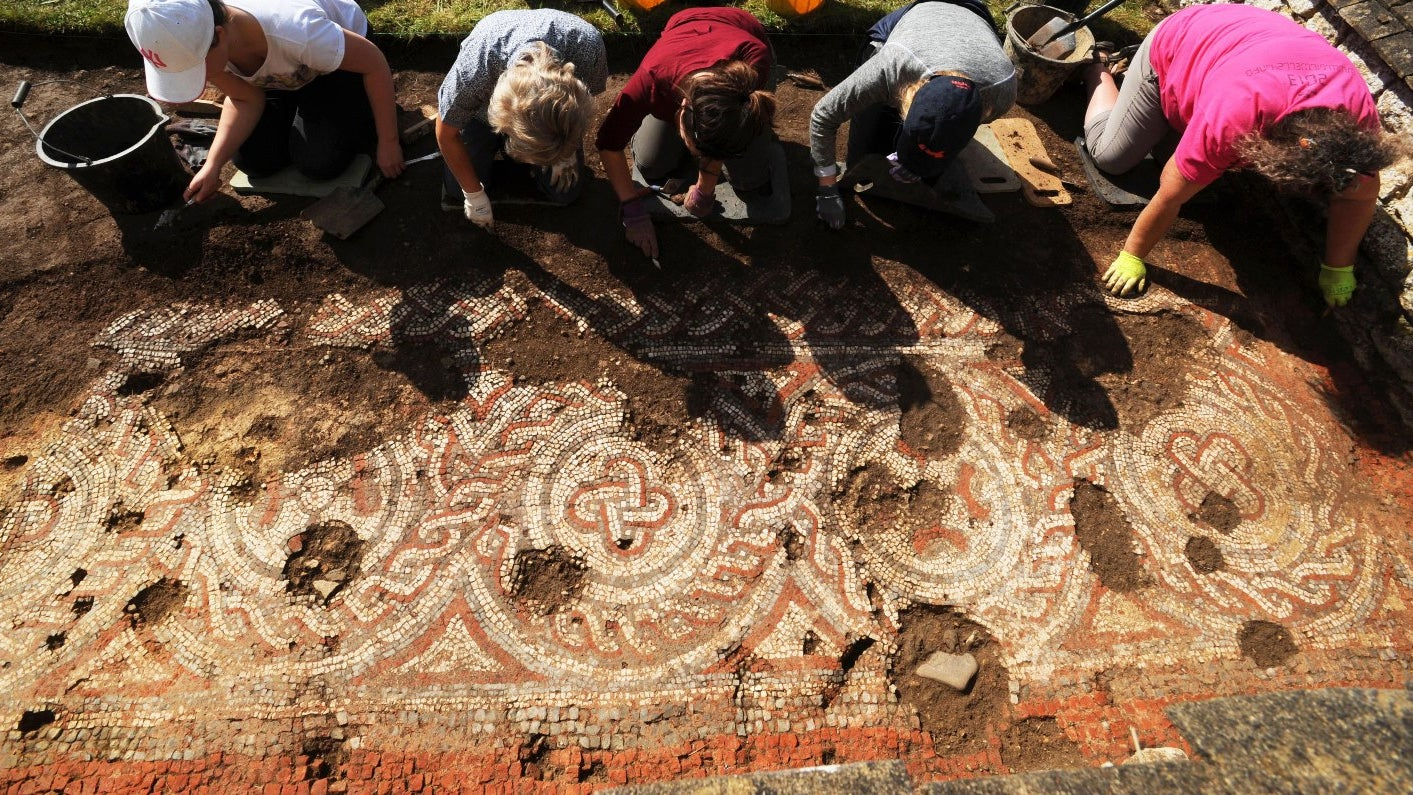 Volunteers uncovering a mosaic not seen since the Victorian excavations