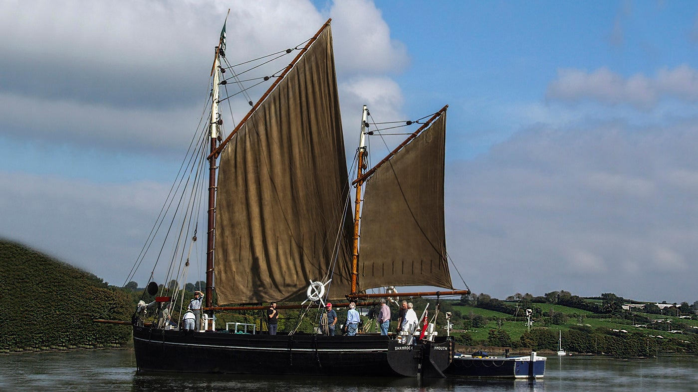 Tamar sailing barge Shamrock with her sails up at Cotehele, Cornwall