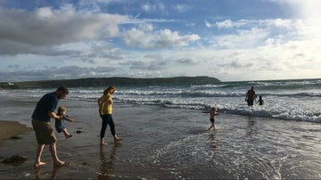 Family playing in the sea at Woolacombe