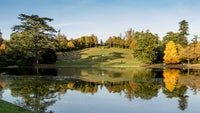 The amphitheatre and lake in autumn at Claremont Landscape Garden, Surrey