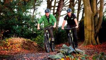 Two cyclists on the trails at Castle Ward, Co. Down