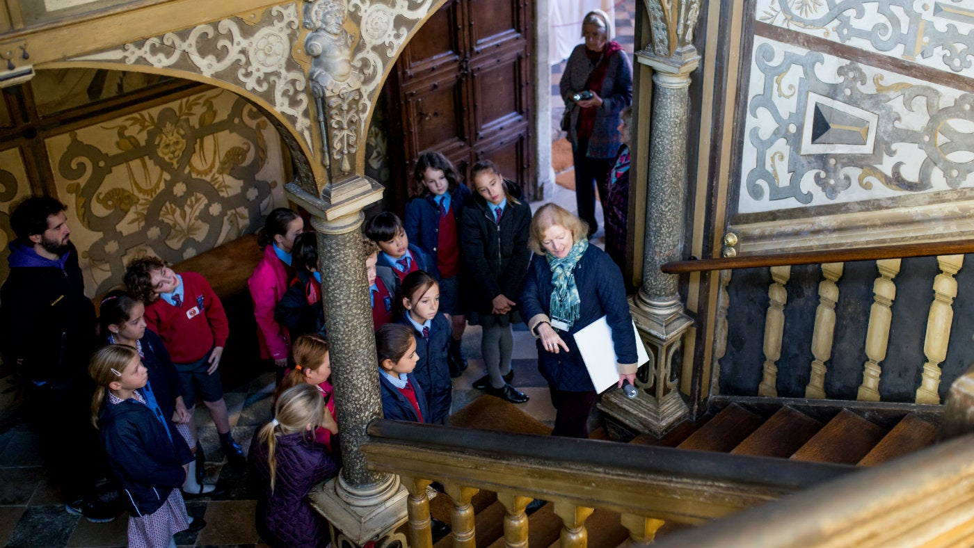 A primary school group explore the Great Staircase at Knole