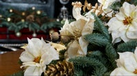 Floral decoration of evergreens with seasonal flowers