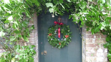 The cottage front door with a festive wreath