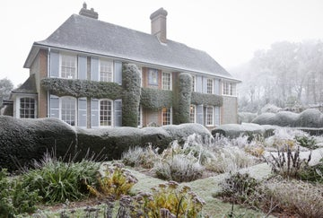 Winter frost covers the garden and house at Nuffield Place.