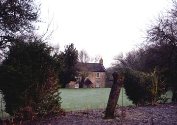 The frosty lawn at Cherryburn with the farmhouse in the distance