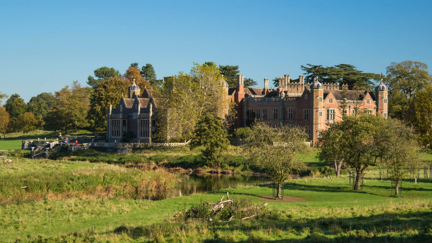 View of Charlecote Park house from parkland in autumn