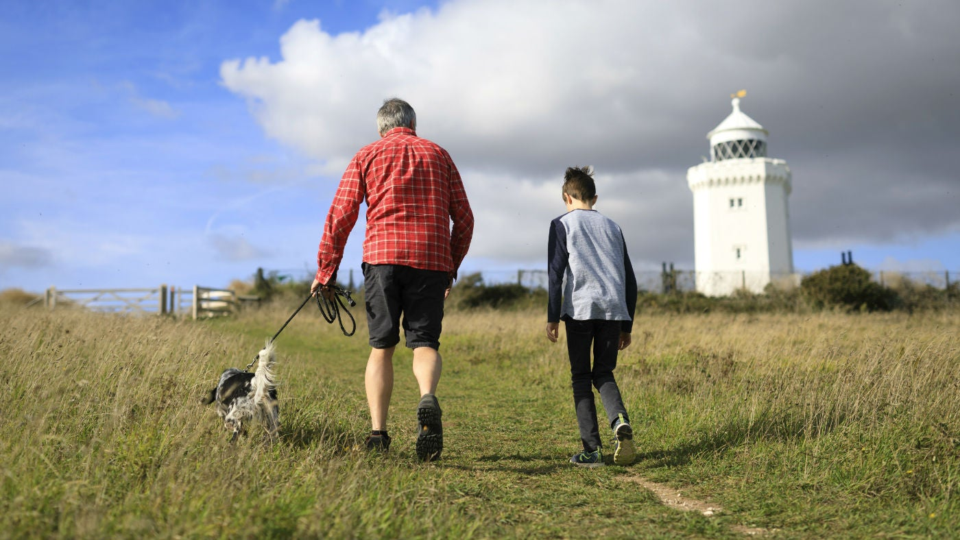 Visitors walking their dog at South Foreland Lighthouse, White Cliffs, Kent