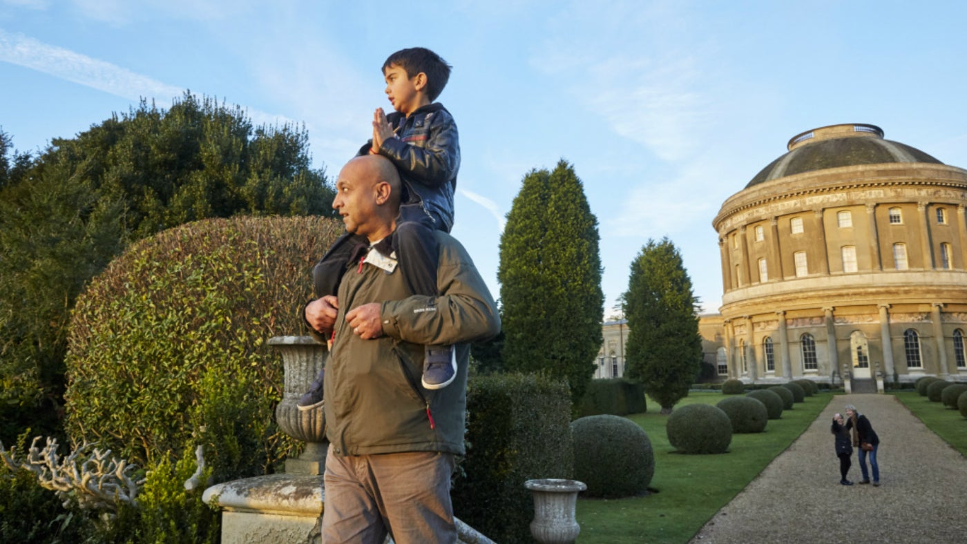 Child on fathers shoulders in Ickworth's Italianate Garden