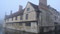 Ightham Mote house is shrouded in mist