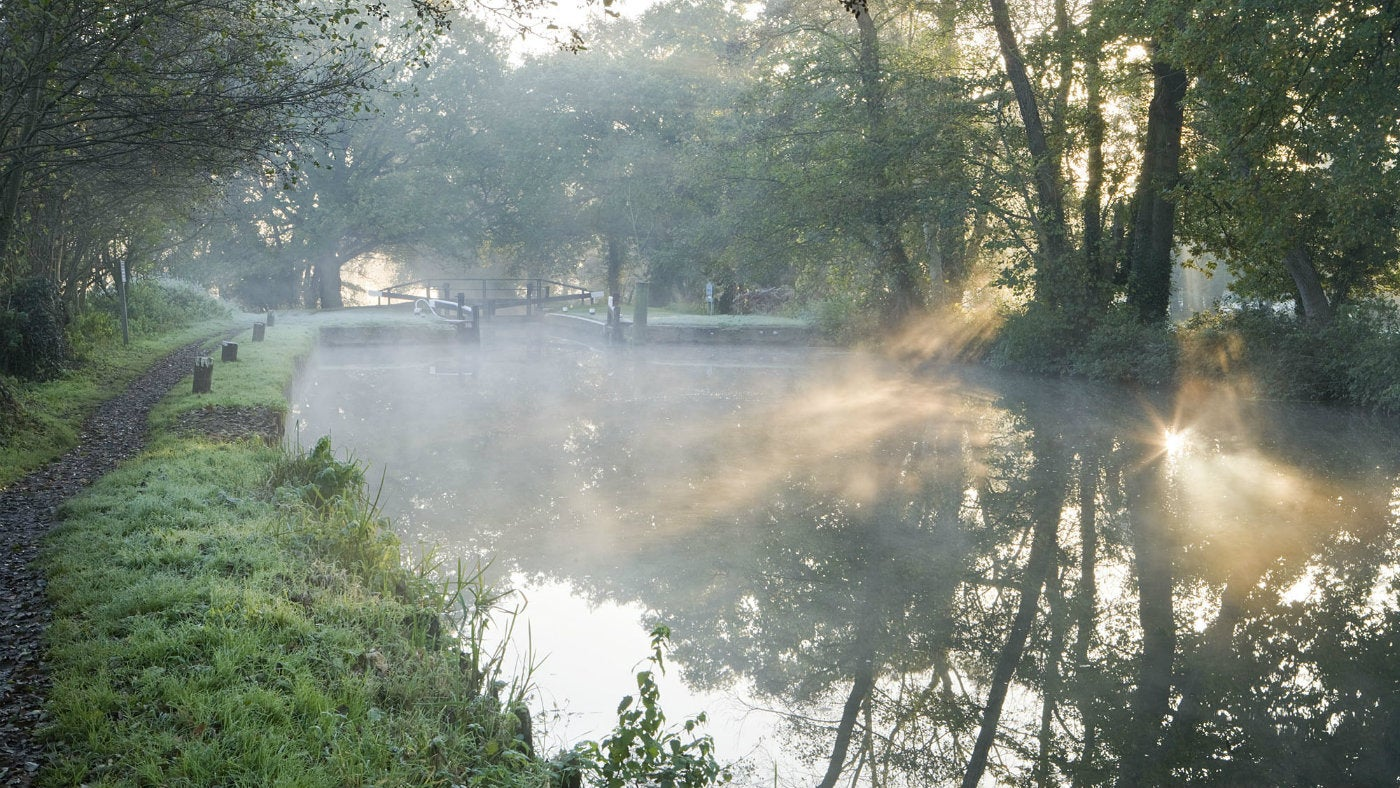 Newark lock on the river Wey on a misty autumn morning