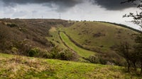 Dark clouds gather over the steep-sided Coombe Bottom below Ventnor radar station