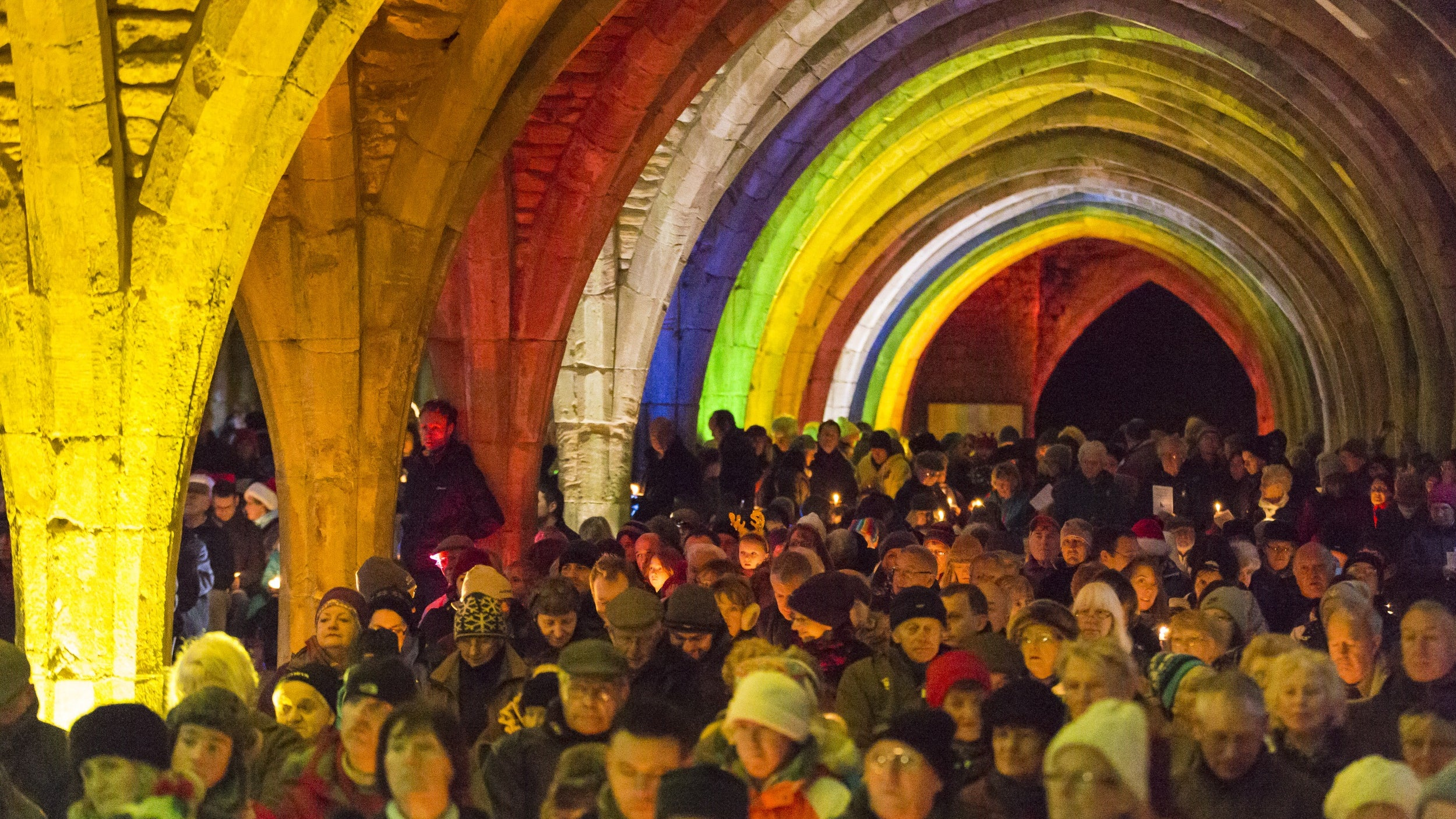 Crowds gather to sing carols at Fountains Abbey