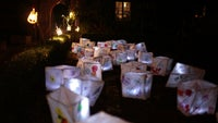 Candlelit white withy and tissue paper lanterns