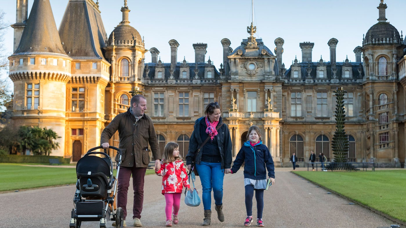 A family walking in the grounds of Waddesdon Manor, a National Trust property in Buckinghamshire
