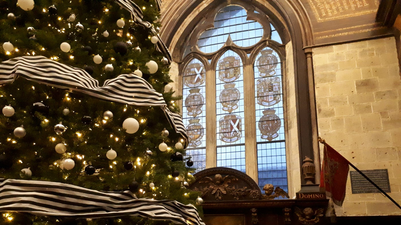 A decorated 20 foot Christmas tree in the Chapel at Petworth House
