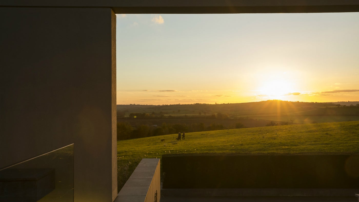 Dog walkers at Windmill Hill at Waddesdon Manor, a National Trust property in Buckinghamshire