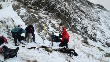 Rangers install ice monitor station Great End, Borrowdale, Lake District